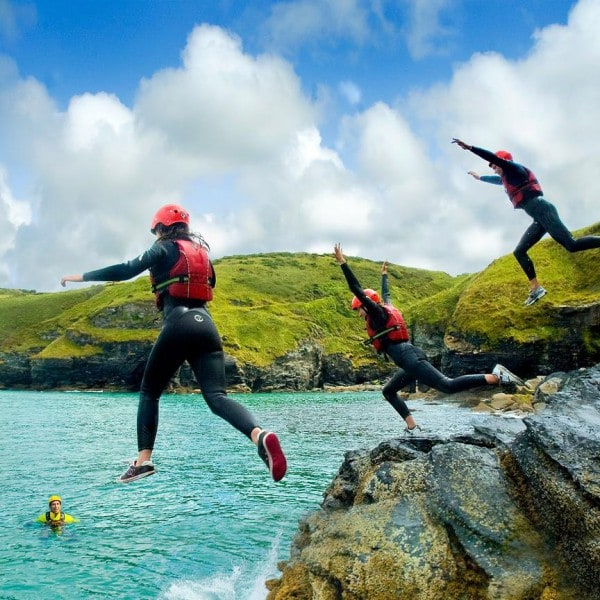 Coasteering cliff jump in Bude, Cornwall