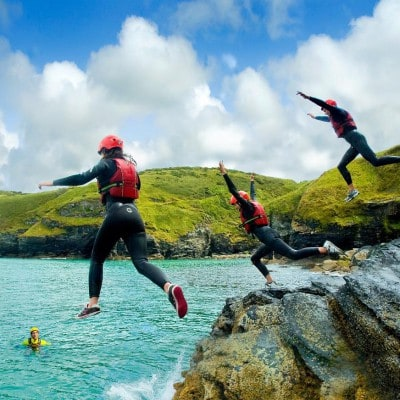 Coasteering session with cliff jumping and headland swims on an activity break