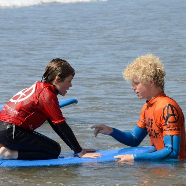 Surfing lesson on a school residential activity trip