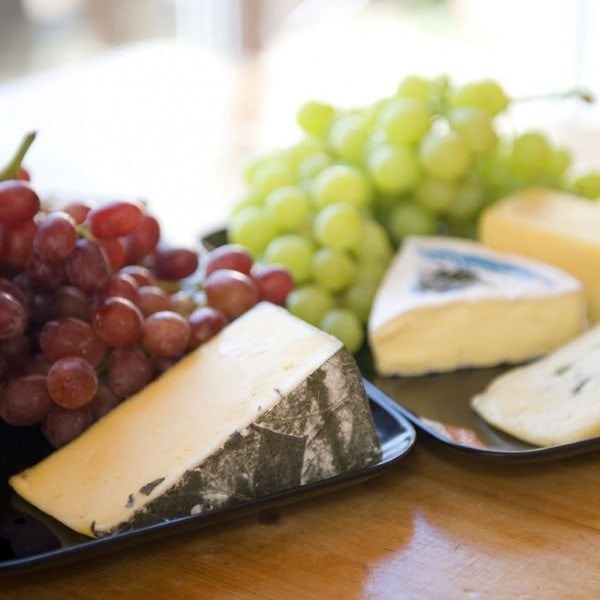 Selection of fine looking cheeses with crackers and grapes