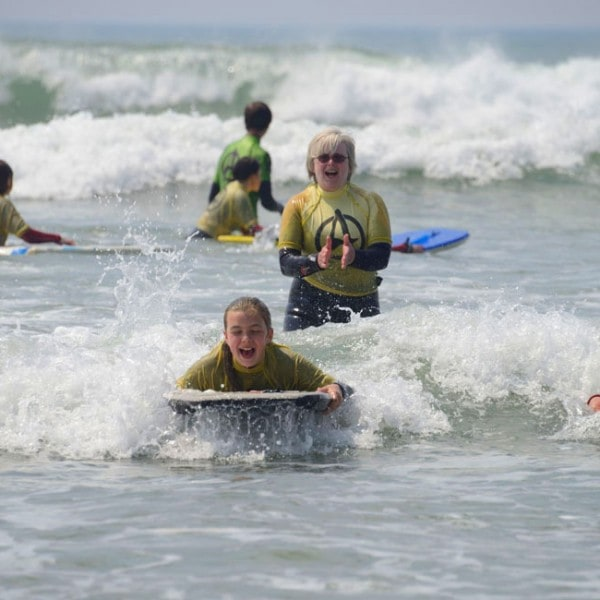 School groups body boarding in Widemouth Bay