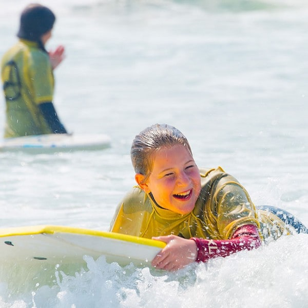 Body boarding on a family adventure holiday