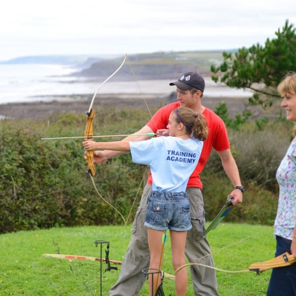 Archery instruction on summer holiday