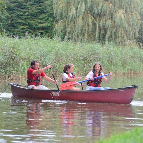 Family working out how to turn a canoe around