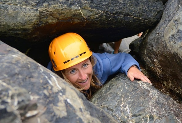 Woman smiling in a rock cave