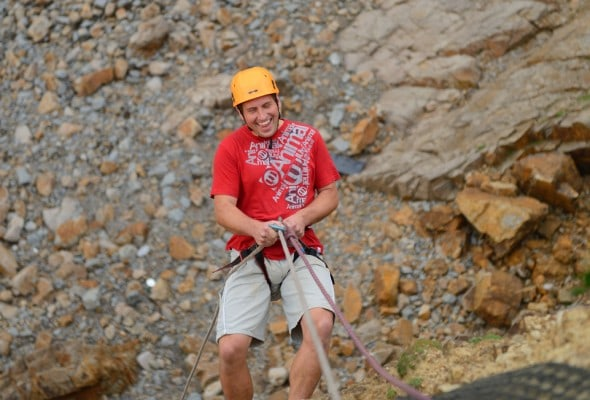 Stag activity group half way down 80ft seacliff abseil onto Widemouth Bay beach
