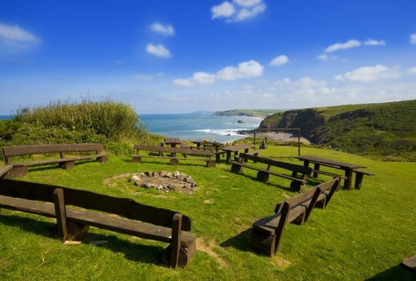 Seating area and fire pit in Outdoor Adventure grounds Cornwall