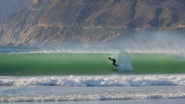 A surfer riding a barrel of a wave on a perfect day!