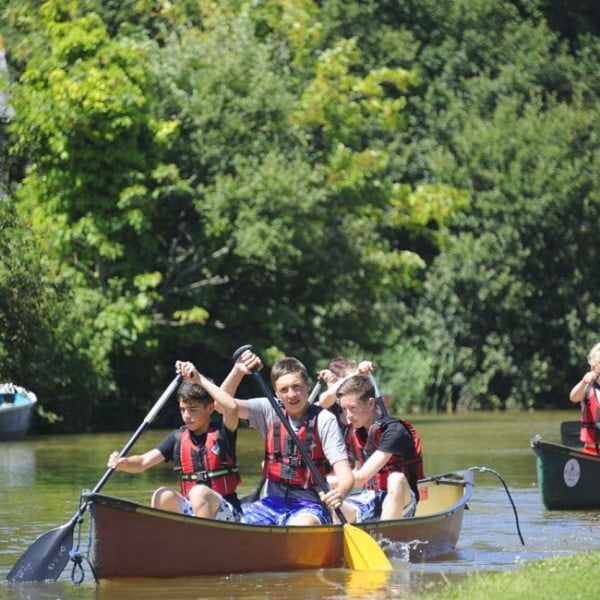 Groups of kayakers taking part in our school residential trips