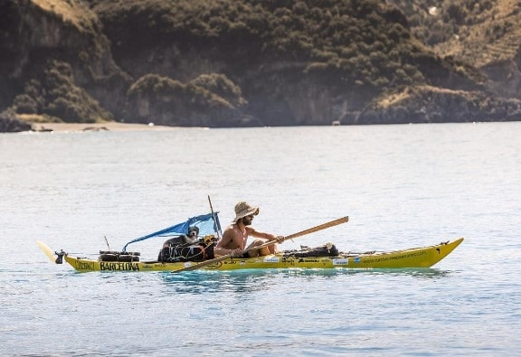 Sergi Basoli on kayak with his pet dog