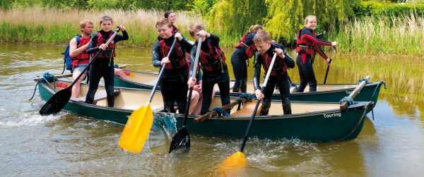 Kids in group canoeing activity from our school residential trips