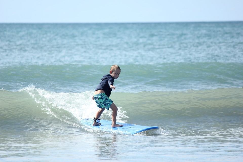 Kids learning to surf at our outdoor activity centres UK