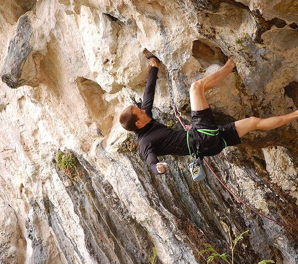 A man Sport Climbing on an overhanging rock near Outdoor Adventure