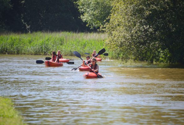 People kayaking on a primary school residential trip