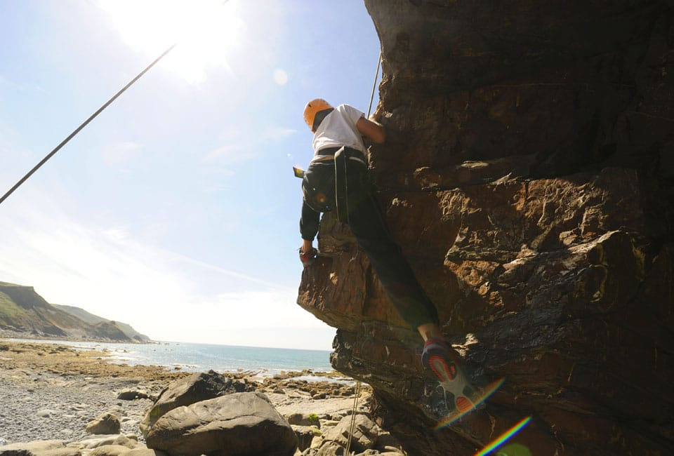 Mum on her first rock climb on a family activity holiday in the UK