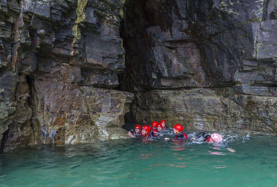 outdoor instructor course group coasteering in mouth of cave