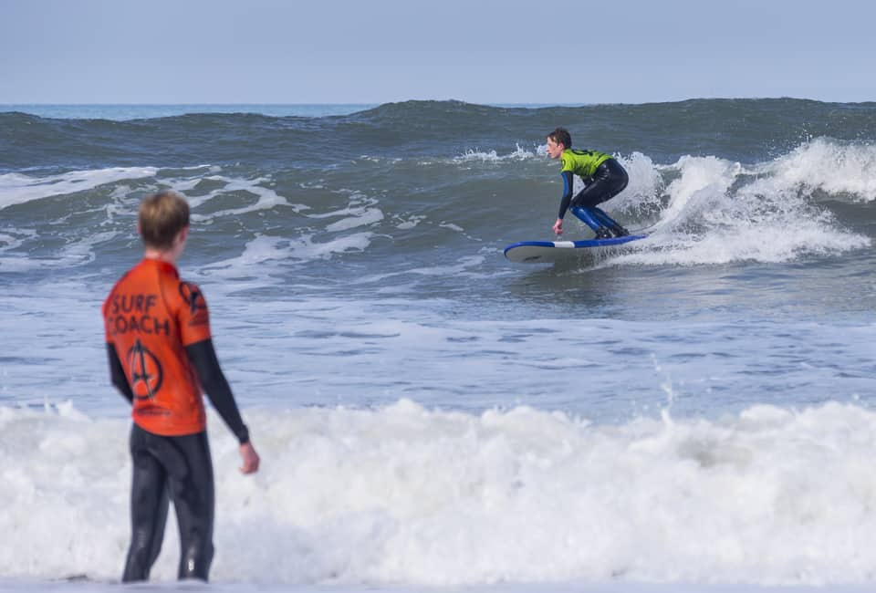 Child surfing on a family adventure holiday in Cornwall UK