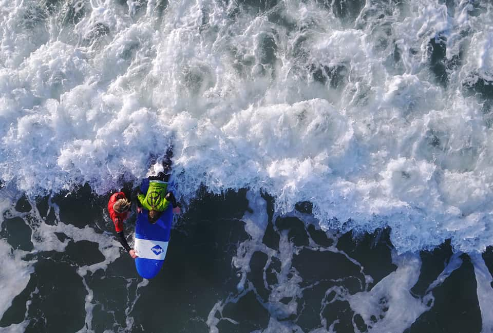 outdoor instructor course member surfing at Bude in Cornwall from above