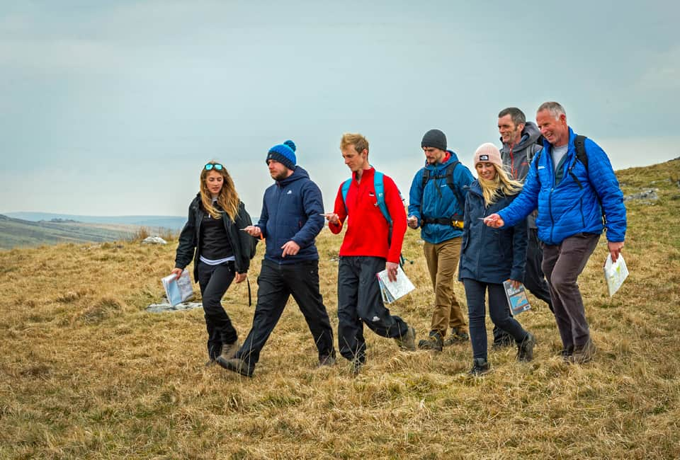 outdoor instructor course group navigating by compass