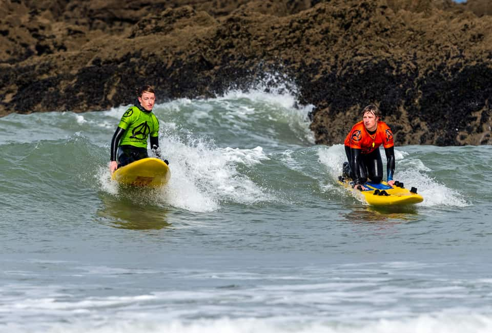 outdoor instructor training on surf rescue boards