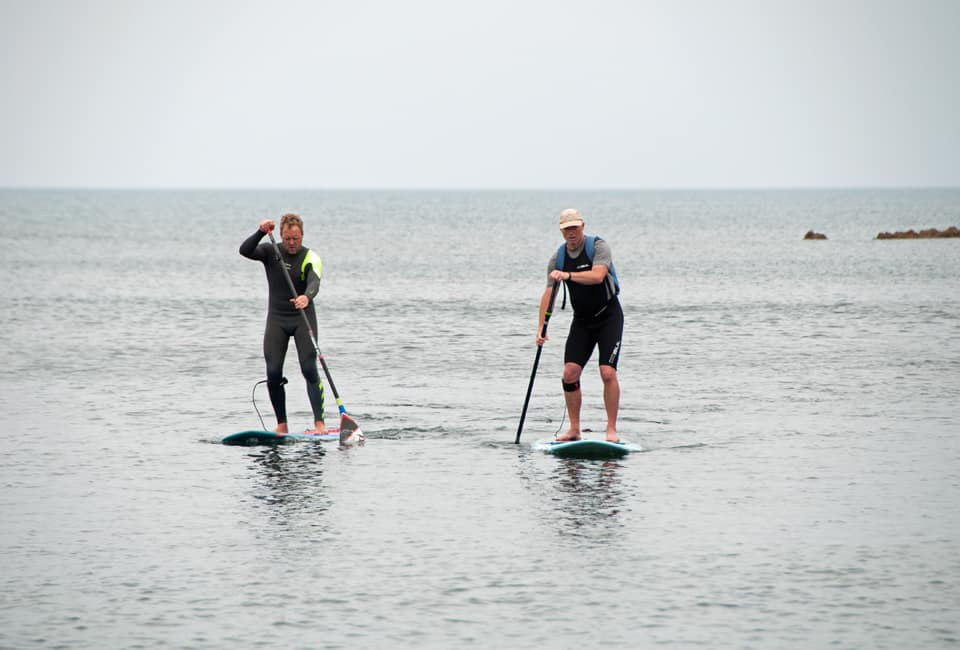 outdoor instructor course members paddling SUP's on calm sea